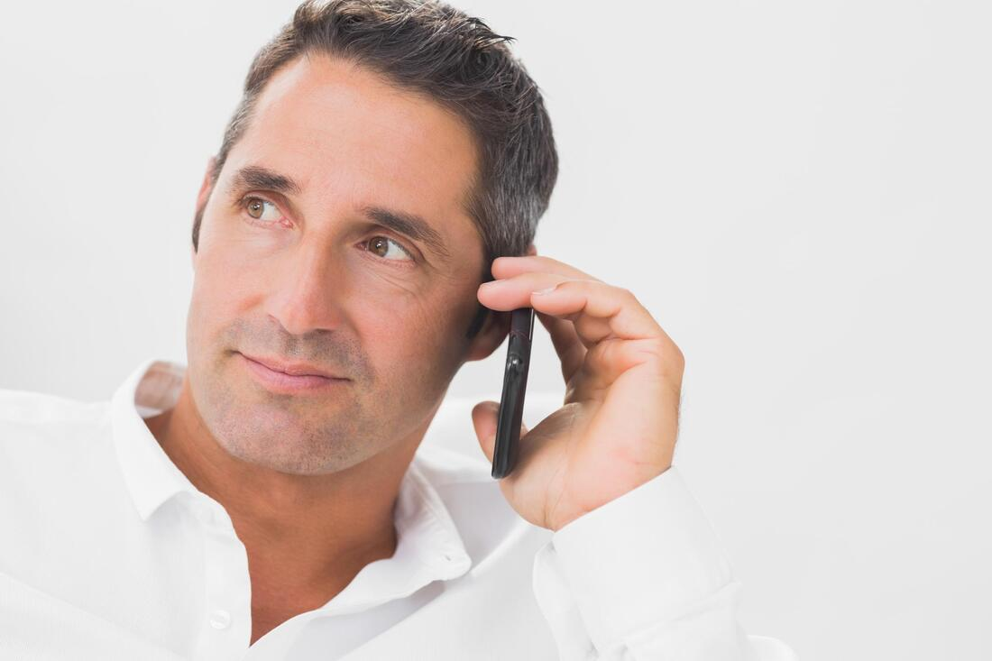 man smile taking phone call