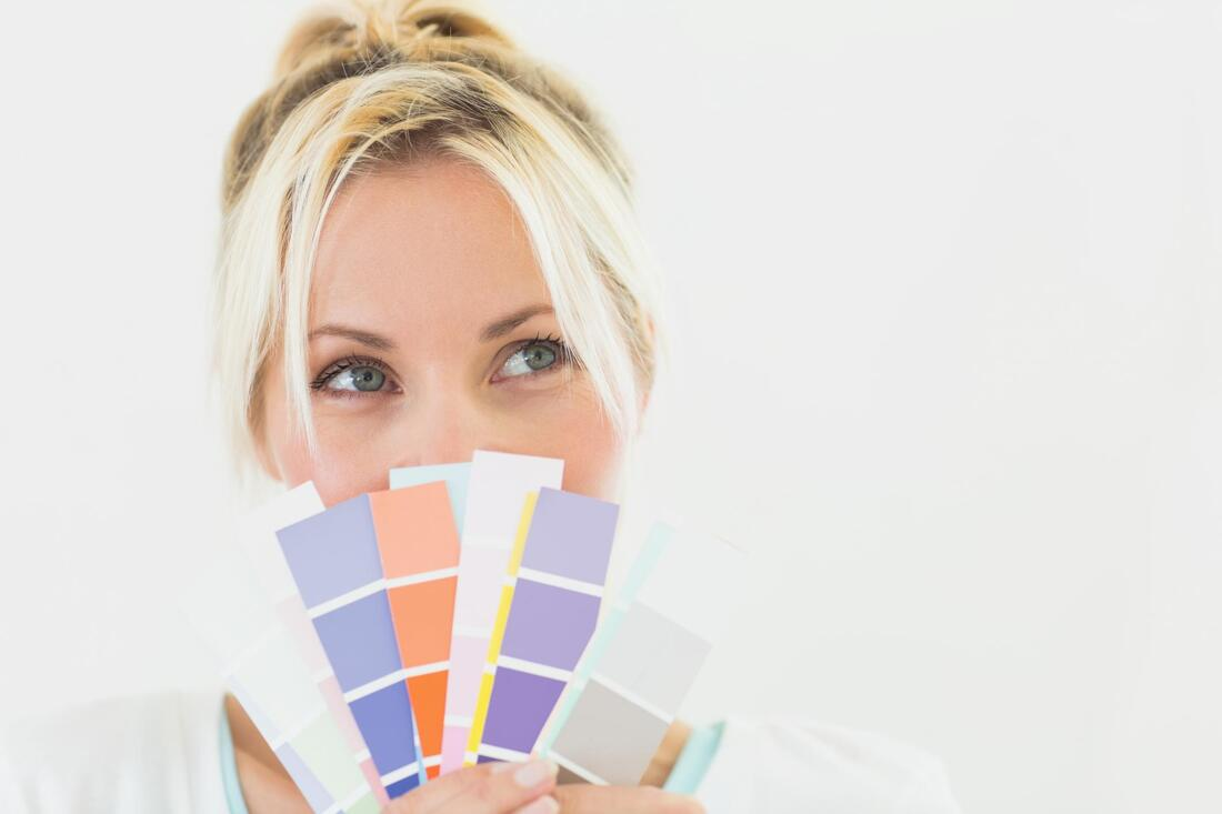 woman holding colors smiling
